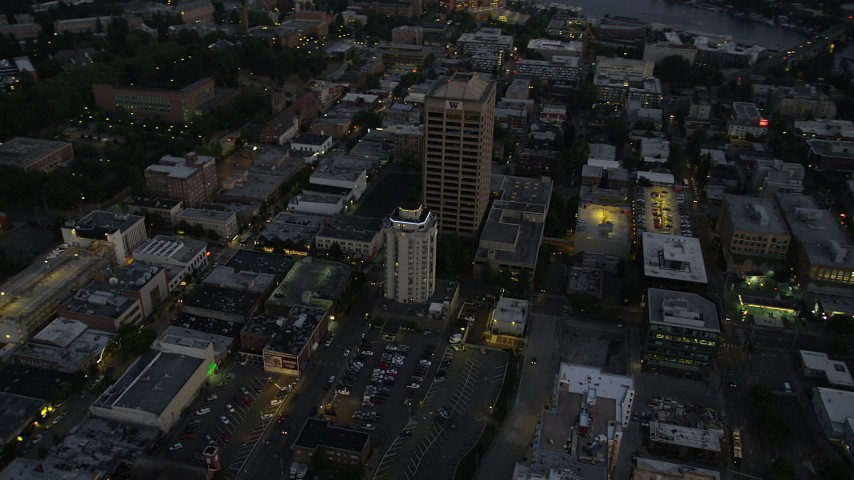 5K stock footage aerial video orbit University District office buildings, and tilt to reveal the bridge and Lake Union, Seattle, Washington, twilight Aerial Stock Footage | AX50_085