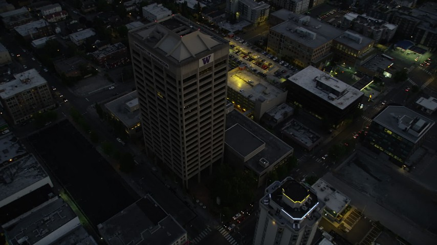 5K stock footage aerial video fly over office buildings in the University District, Seattle, Washington, twilight Aerial Stock Footage | AX50_086