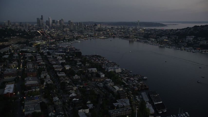 5K stock footage aerial video fly over the Capitol Hill neighborhood and Lake Union to approach Downtown Seattle skyline, twilight Aerial Stock Footage | AX50_088