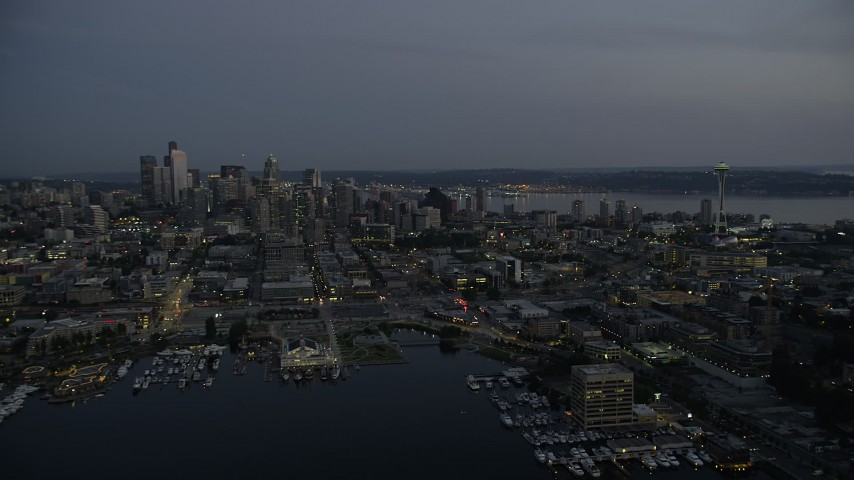 5K stock footage aerial video fly over the shore of Lake Union, with a view of skyscrapers and the Space Needle in Downtown Seattle, Washington, twilight Aerial Stock Footage | AX50_089