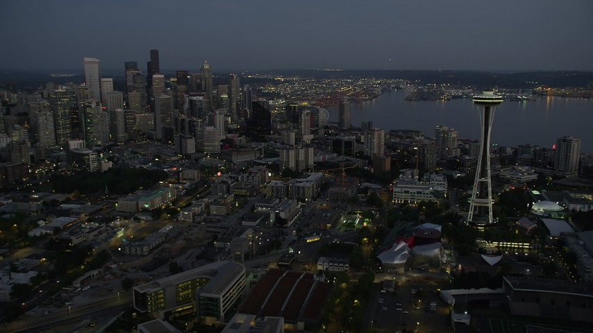 5K stock footage aerial video of a view of Downtown Seattle's tall skyscrapers seen while flying by the Space Needle, Washington, twilight Aerial Stock Footage | AX50_090