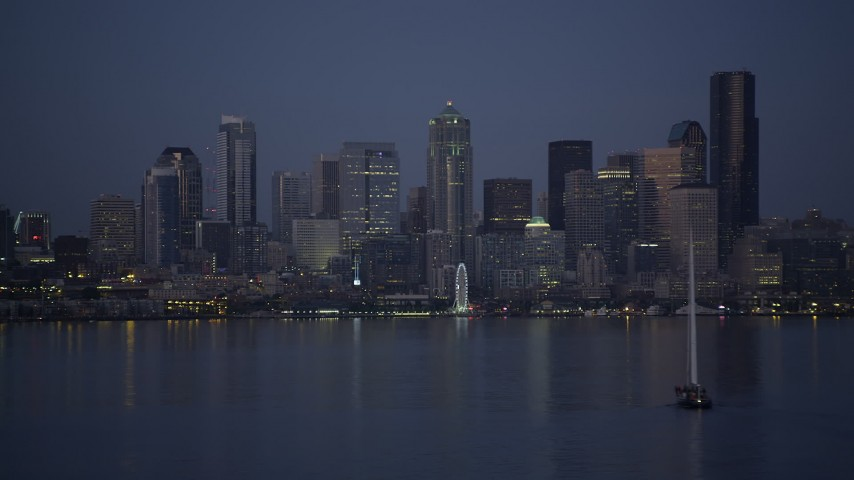 5K stock footage aerial video orbit sailboat to reveal Downtown Seattle skyline, Washington, twilight Aerial Stock Footage | AX50_095