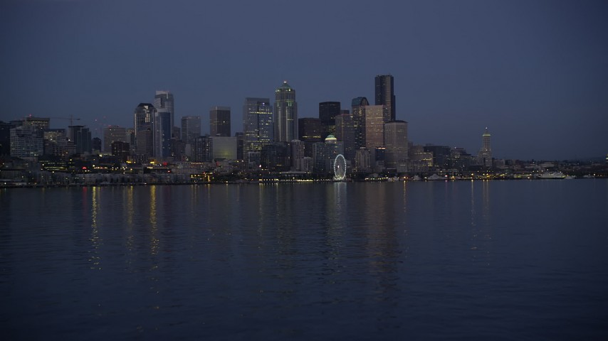 5K stock footage aerial video of low approach to Downtown Seattle skyline at twilight, Washington Aerial Stock Footage | AX50_096