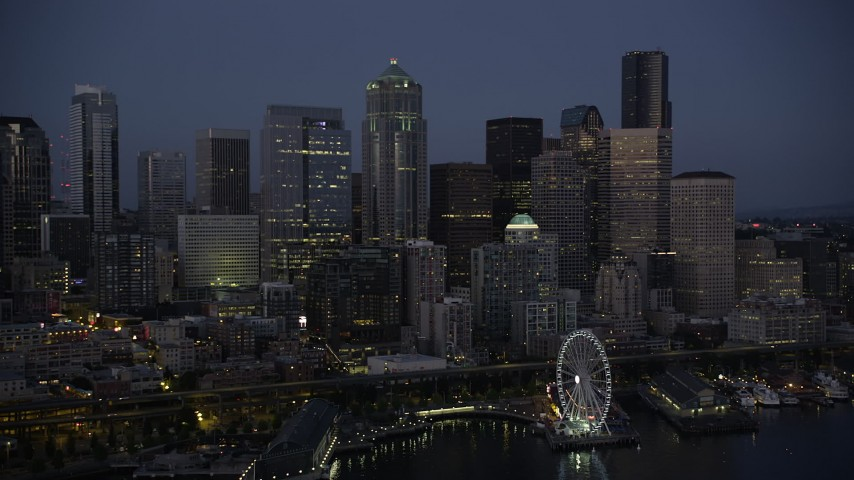 5K stock footage aerial video of approach the Seattle Waterfront and Downtown Seattle skyline at twilight, Washington Aerial Stock Footage | AX50_097