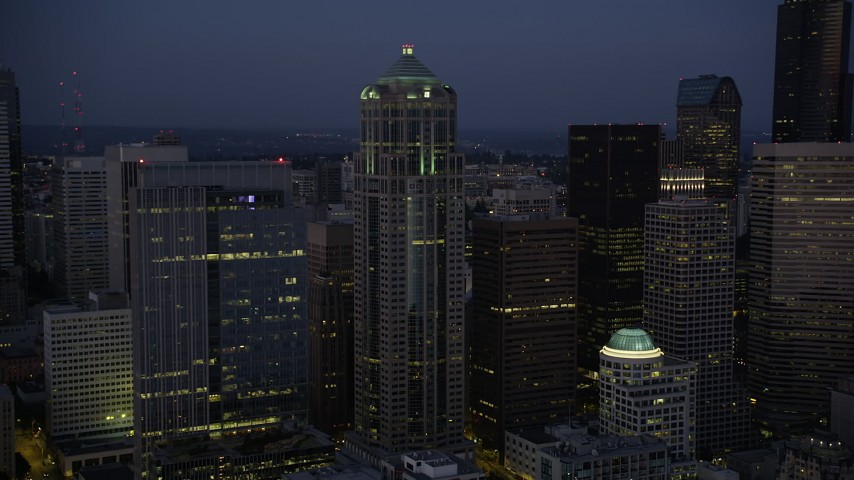 5K stock footage aerial video of approach and flyby 1201 Third Avenue Tower at twilight in Downtown Seattle, Washington Aerial Stock Footage | AX50_098