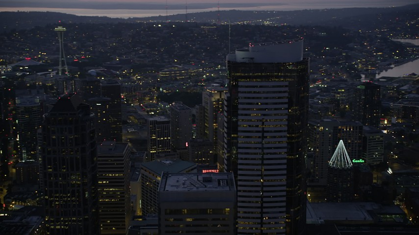 5K stock footage aerial video orbit the Two Union Square skyscraper at twilight in Downtown Seattle, Washington Aerial Stock Footage | AX50_099