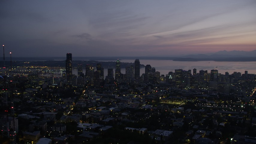 5K stock footage aerial video of a wide view of Downtown Seattle, Washington, at twilight, with Elliott Bay in the background Aerial Stock Footage | AX50_100
