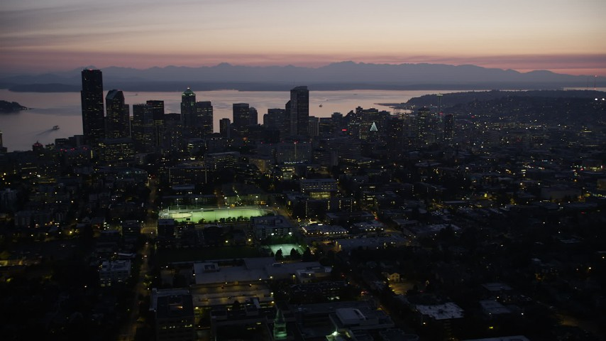 5K stock footage aerial video of Downtown Seattle skyscrapers and Elliot Bay, Washington, twilight Aerial Stock Footage | AX50_101