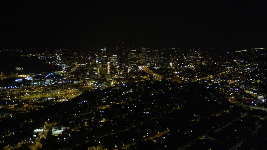 5K stock footage aerial video approach Downtown Seattle from Beacon Hill at night, Washington Aerial Stock Footage | AX51_006