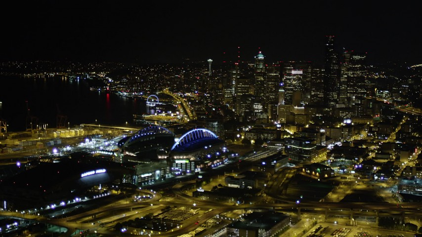 5K stock footage aerial video approach Safeco and CenturyLink Fields, with a view of Downtown Seattle skyscrapers, Washington, night Aerial Stock Footage | AX51_007
