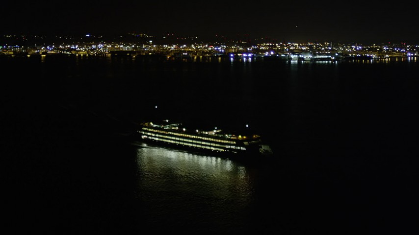 5K stock footage aerial video track a ferry sailing Elliott Bay and reveal Downtown Seattle skyline, Washington, night Aerial Stock Footage | AX51_011