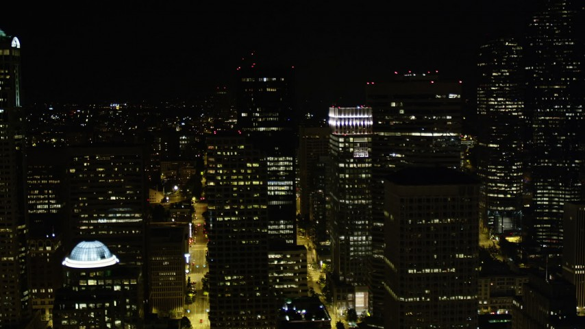 5K stock footage aerial video flyby tall skyscrapers in Downtown Seattle, Washington, night Aerial Stock Footage | AX51_015