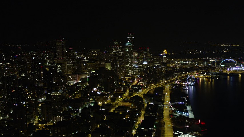 5K stock footage aerial video of Downtown Seattle skyscrapers and the Central Waterfront in Washington at night Aerial Stock Footage | AX51_025