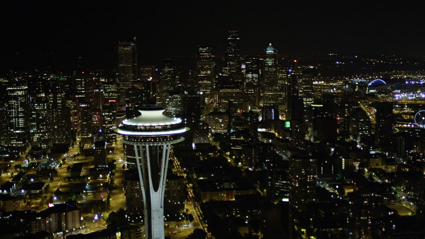 5K stock footage aerial video of a view of Downtown Seattle skyscrapers, reveal the Space Needle, Washington, night Aerial Stock Footage AX51_026 | Axiom Images