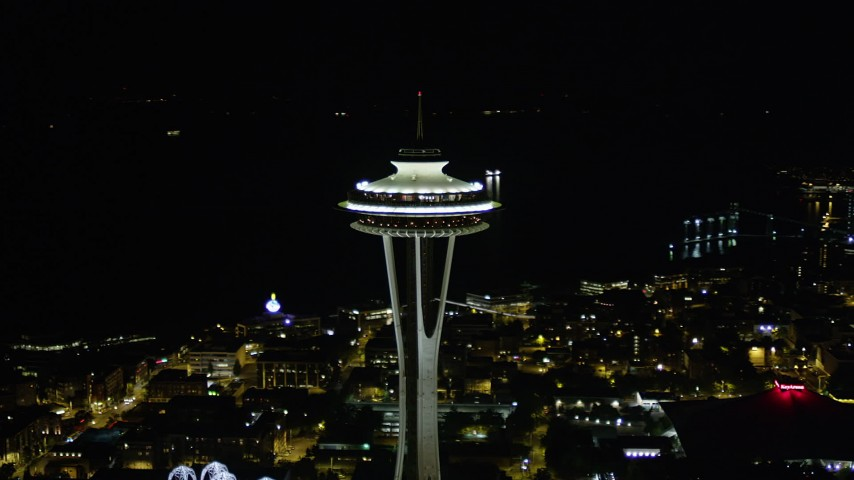 5K stock footage aerial video orbit top of the Seattle Space Needle at night, Downtown Seattle, Washington Aerial Stock Footage | AX51_028