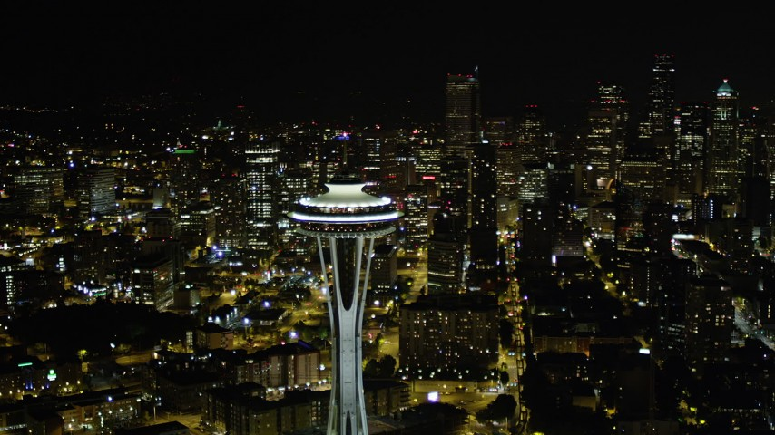 5K stock footage aerial video orbit the Space Needle and reveal Downtown Seattle skyscrapers in Washington at night Aerial Stock Footage | AX51_030