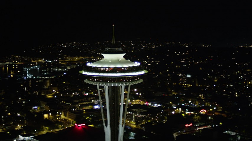 5K stock footage aerial video orbit Space Needle in Downtown Seattle, with Elliott Bay in the background, Washington, night Aerial Stock Footage | AX51_031