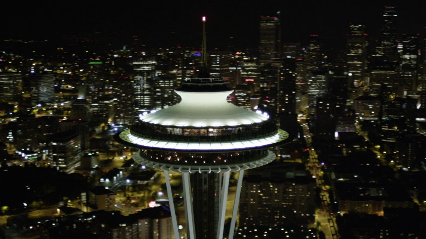 5K stock footage aerial video of close-up orbit of the top of the Space Needle at night in Downtown Seattle, Washington Aerial Stock Footage | AX51_032