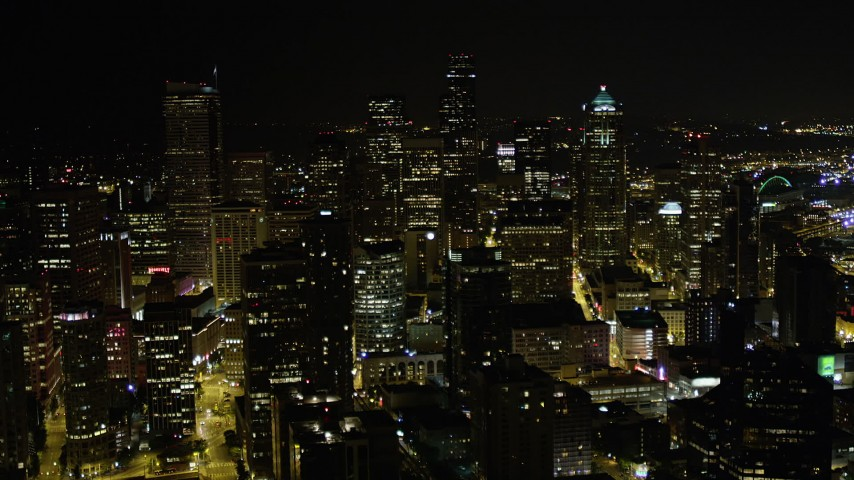 5K stock footage aerial video approach Downtown Seattle skyscrapers and high-rises at night, Washington Aerial Stock Footage | AX51_033