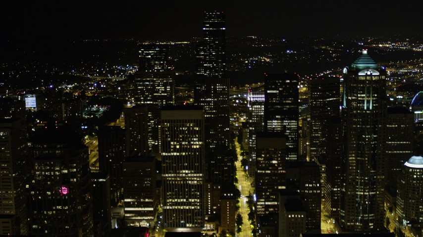 5K stock footage aerial video approach Seattle Municipal Tower and Columbia Center at night in Downtown Seattle, Washington Aerial Stock Footage | AX51_034