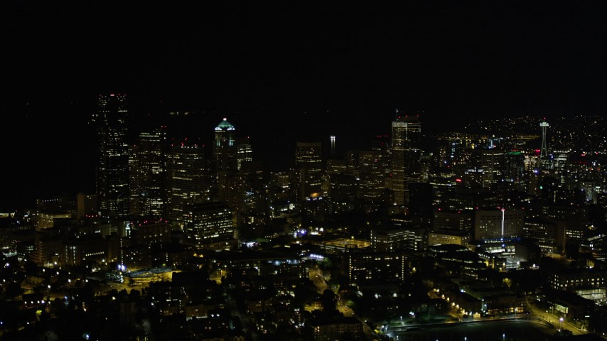 5K stock footage aerial video of tall skyscrapers in Downtown Seattle, Washington, night Aerial Stock Footage | AX51_036