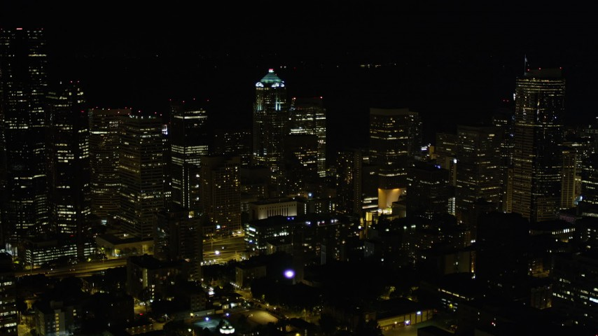 5K stock footage aerial video approach Downtown Seattle skyscrapers and high-rises at night, Washington Aerial Stock Footage | AX51_037