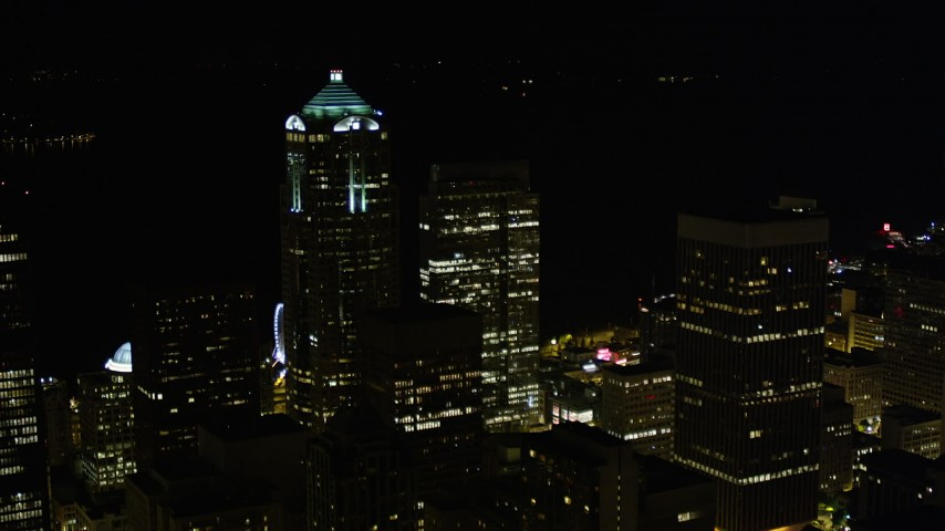 5K stock footage aerial video approach 1201 Third Avenue Tower in Downtown Seattle, Washington, night Aerial Stock Footage | AX51_038