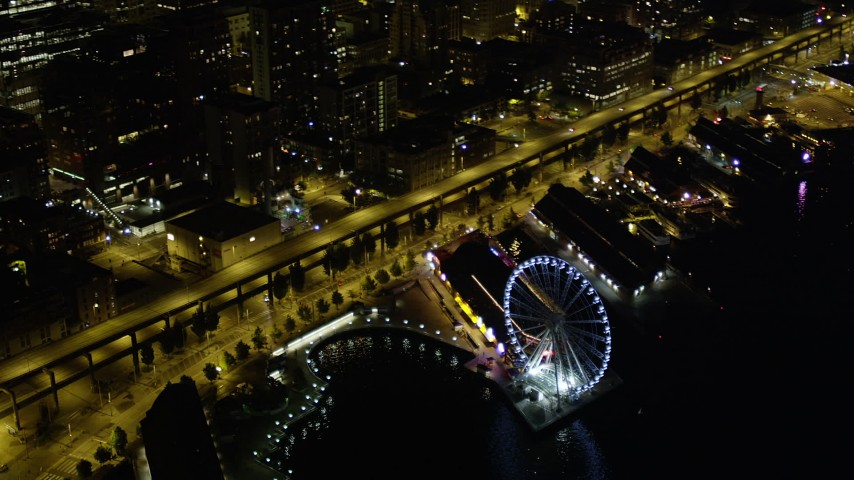 5K stock footage aerial video orbit the Seattle Great Wheel at the Central Waterfront, Downtown Seattle, Washington, night Aerial Stock Footage | AX51_040