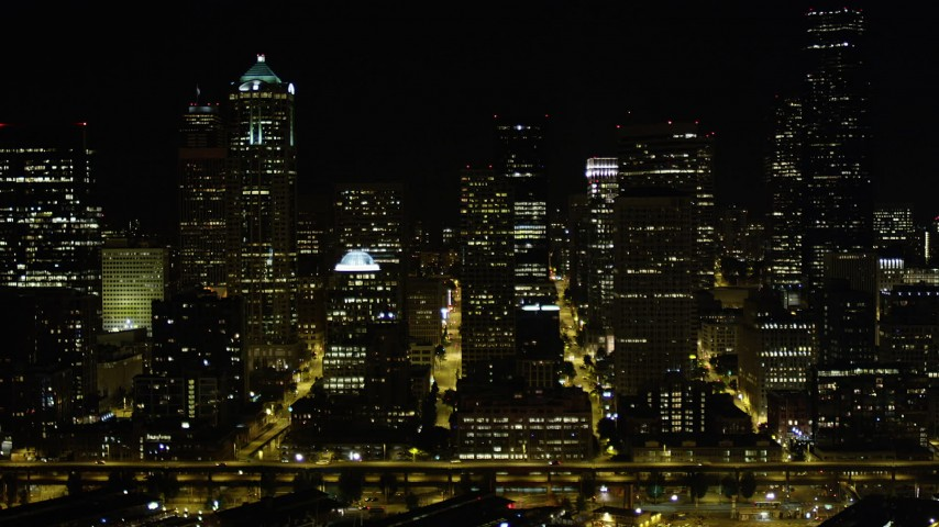 5K stock footage aerial video of a view of Downtown Seattle skyscrapers at nighttime, Washington Aerial Stock Footage | AX51_041