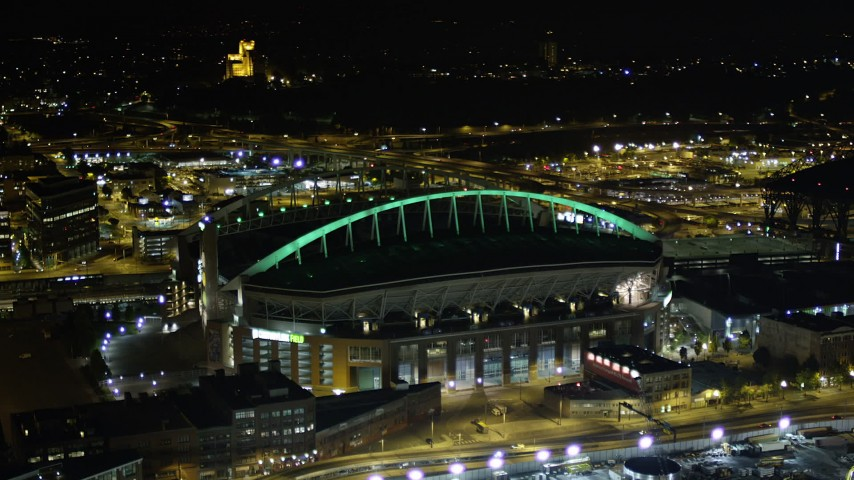 5K stock footage aerial video of CenturyLink Field football stadium in Downtown Seattle, Washington, night Aerial Stock Footage | AX51_042