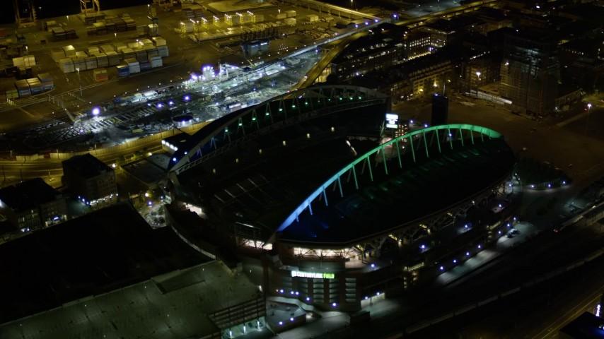 5K stock footage aerial video approach the CenturyLink Field football stadium in Downtown Seattle, Washington, night Aerial Stock Footage | AX51_050