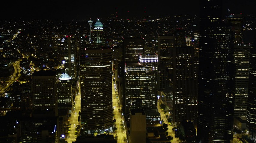 5K stock footage aerial video fly north to approach skyscrapers and high-rises in Downtown Seattle, Washington, night Aerial Stock Footage | AX51_051