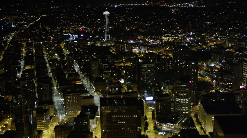 5K stock footage aerial video fly over skyscrapers in Downtown Seattle to approach the Space Needle, Washington, night Aerial Stock Footage | AX51_052