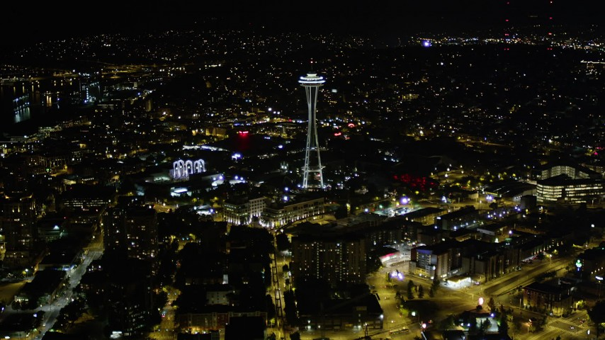 5K stock footage aerial video approach the Space Needle and Seattle Center, Downtown Seattle, Washington, night Aerial Stock Footage | AX51_053