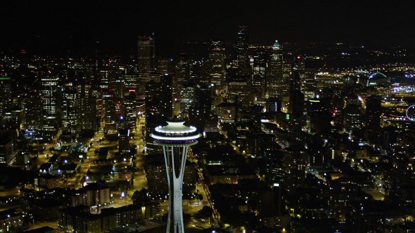 5K stock footage aerial video of Space Needle with Downtown Seattle skyscrapers in the background, Washington, night Aerial Stock Footage | AX51_056