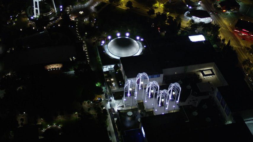 5K stock footage aerial video of a bird's eye view of the Pacific Science Center at Seattle Center, Downtown Seattle, Washington, night Aerial Stock Footage | AX51_057