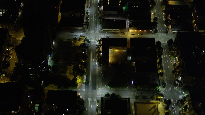 5K stock footage aerial video of bird's eye view of 3rd Avenue through Downtown Seattle, Washington, night Aerial Stock Footage | AX51_058