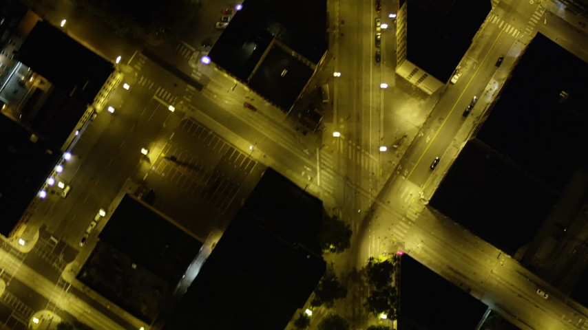 5K stock footage aerial video of bird's eye pan across parking lots to reveal city streets, Downtown Seattle, Washington, night Aerial Stock Footage | AX51_062