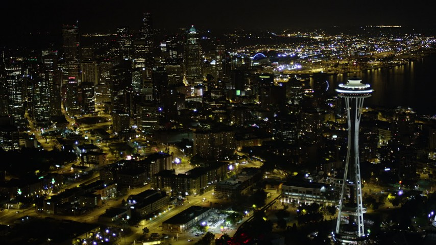 5K stock footage aerial video flyby the Space Needle to approach Downtown Seattle skyscrapers, Washington. night Aerial Stock Footage | AX51_067