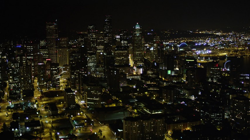5K stock footage aerial video approach skyscrapers and high-rises in Downtown Seattle, Washington, night Aerial Stock Footage | AX51_068