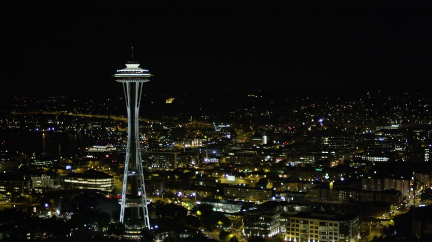5K stock footage aerial video of slow approach to the top of the Space Needle, Downtown Seattle, Washington, night Aerial Stock Footage AX51_074