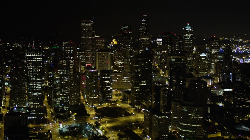 5K stock footage aerial video of towering skyscrapers in Downtown Seattle, Washington, night Aerial Stock Footage | AX51_076