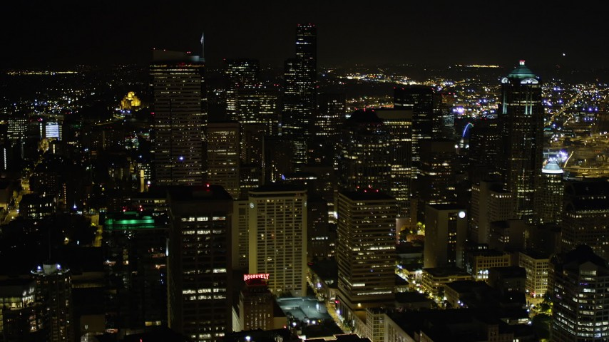 5K stock footage aerial video approach top of Two Union Square in Downtown Seattle, Washington, night Aerial Stock Footage | AX51_077