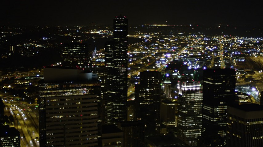 5K stock footage aerial video orbit Two Union Square in Downtown Seattle, Washington, at night Aerial Stock Footage | AX51_080