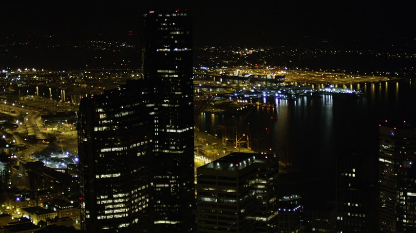 5K stock footage aerial video approach Seattle Municipal Tower and Columbia Center in Downtown Seattle, Washington, at night Aerial Stock Footage | AX51_082