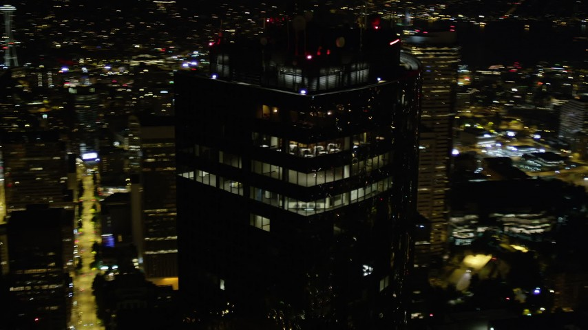 5K stock footage aerial video orbit top floors of Columbia Center at night in Downtown Seattle, Washington Aerial Stock Footage | AX51_083
