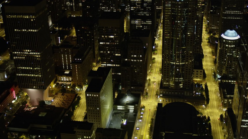 5K stock footage aerial video flyby city streets and skyscrapers in Downtown Seattle, Washington, night Aerial Stock Footage | AX51_085