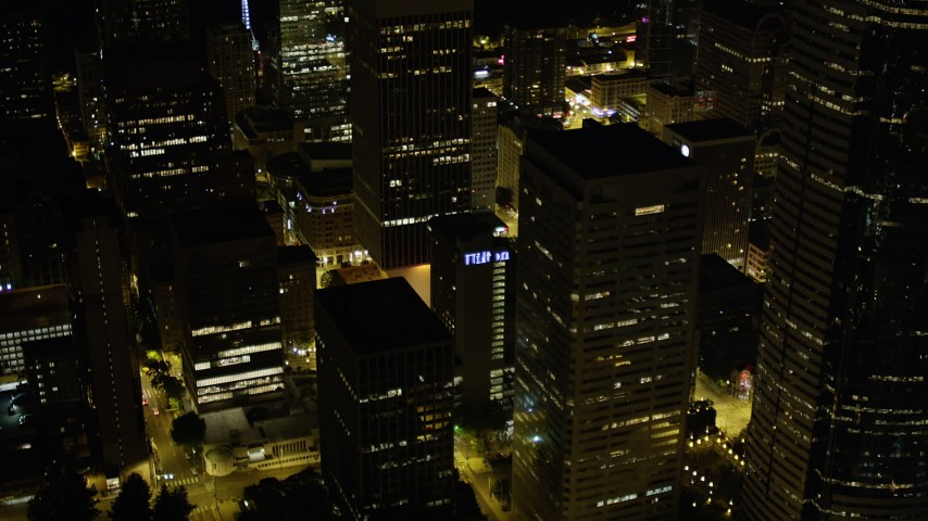 5K stock footage aerial video reveal base of Rainier Tower in Downtown Seattle, Washington, night Aerial Stock Footage | AX51_086