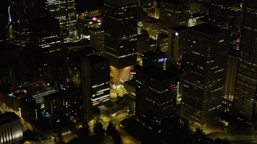 5K stock footage aerial video orbit Rainier Tower and neighboring skyscrapers in Downtown Seattle, Washington, night Aerial Stock Footage | AX51_087