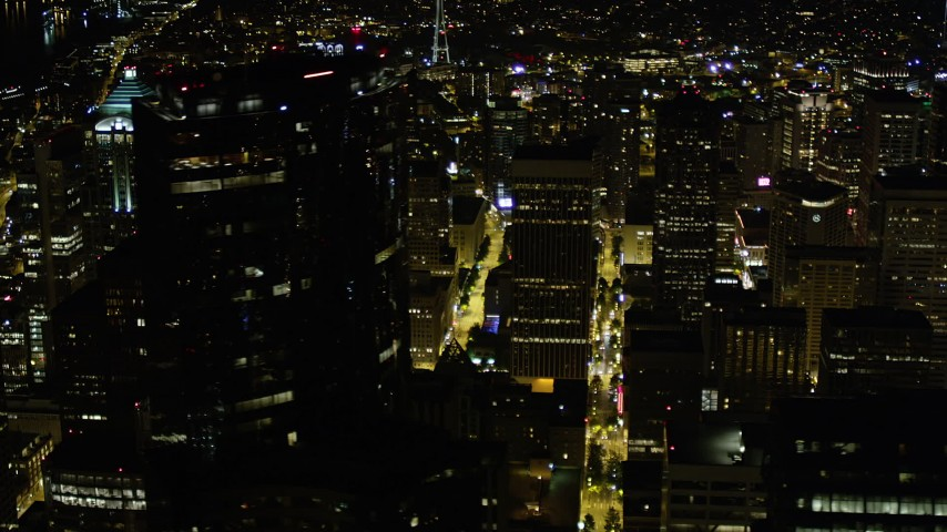5K stock footage aerial video orbit Rainier Tower and Downtown Seattle skyscrapers, Washington, night Aerial Stock Footage | AX51_088
